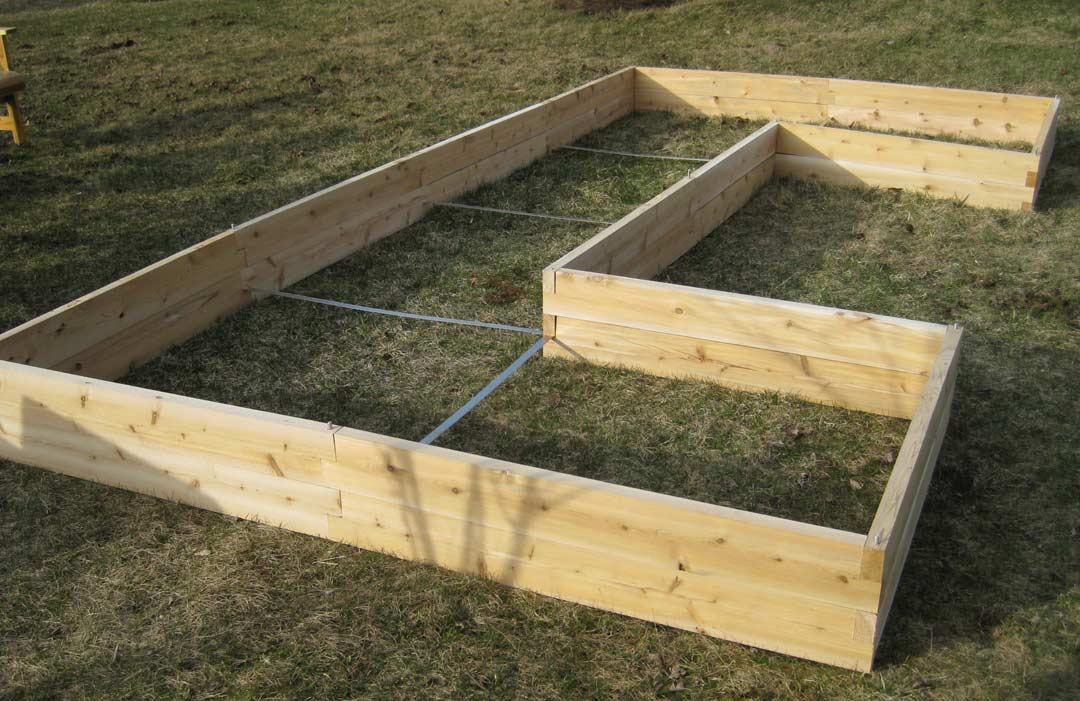 garden design with window boxes and raised garden beds made from cedar with planting bulbs from